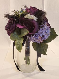 Dark purple bouquet with light purple accents and black flowers