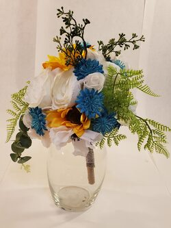 Cute sunflower bouquet with white and blue accents